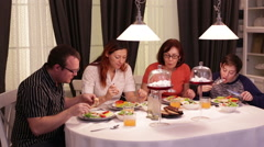 Family of Four Dines at the Table in the Kitchen - stock footage