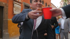 A wedding procession walks down the streets of San Miguel de Allende Stock Footage