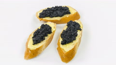 Appetizer with caviar close-up rotation on white background. - stock footage