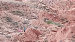 Lost people look for right way in desert, Konorchek, Kyrgyzstan Stock Footage