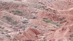 Lost people look for right way in desert, Konorchek, Kyrgyzstan - stock footage