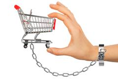 Chained hand holding shopping cart - stock photo