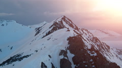 Epic Aerial Flight Over Mountain Peak Edge Range At Sunset Inspirational Winter Stock Footage