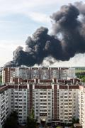 Black smoke from a major fire in Moscow, Russia - stock photo