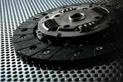 Car clutch on a metal surface - stock photo