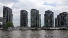 Dolly view of a contemporary riverside real estate development in West London Stock Footage