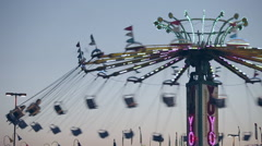 Carnival Swing Carousel Ride Sunset Fair Grounds Amusement Stock Footage