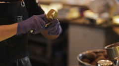 Barista to peel a kiwi in bar - stock footage