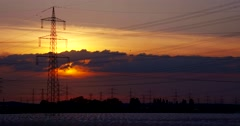 TIME LAPSE sunset with power poles and birds Stock Footage