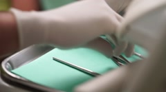 Dentists arranges tools Stock Footage