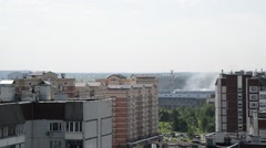 Zelenograd, Russia - May 31.2016. Extinguishing the fire by helicopter Stock Footage