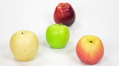 Green, red, yellow apples rotation on a white background, eating timelapse. Stock Footage