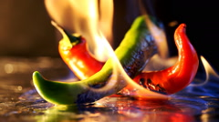 Hot pepper in fire arms Stock Footage