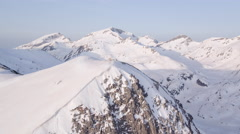 Aerial Flight Spinning Around Mountain Peak Epic Inspirational Flyover Winter Stock Footage