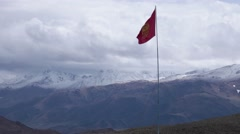Flag of Kyrgyzstan with mountains on the background. Stock Footage