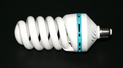 Energy saving lamp isolated on black background. Stock Footage