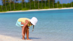 Adorable little girl at white beach during tropical vacation - stock footage