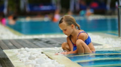 Little adorable girl in outdoor swimming pool Stock Footage