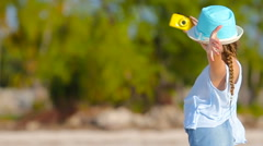 Adorable little girl making selfie in at tropical beach Stock Footage