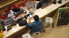 Stylish Hipster Man Using Mobile Phone Relaxing at Bar Counter Stock Footage