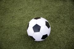 Soccer foot ball on green grass Stock Photos