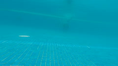 Underwater happy beautiful girl in swimming pool having fun - stock footage