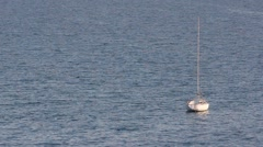 Lonely white sail boat with deflated - stock footage