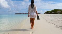 Young beautiful woman enjoying beach tropical vacation - stock footage