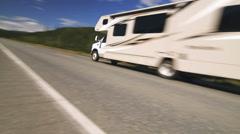 Camper Van On The Country Road. Alaska Stock Footage