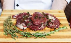 fresh beef meat on a cutting board - stock photo