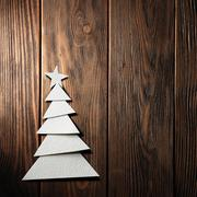 Christmas tree cut out from paper on background - stock photo