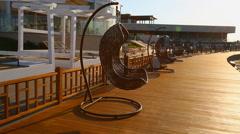 Round modern furniture plastic wicker chairs in garden. Aqua park in Baku, Azerb Stock Footage