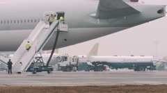 Moscow 2015-05-01: Airplanes and fuel track in airport Domodedovo Stock Footage
