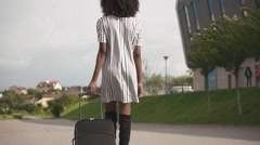 Back view of elegant african american business lady in stylish short dress going Stock Footage