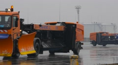 Snowblowers column goinf at runway Stock Footage