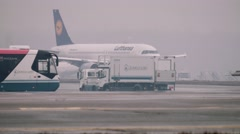 Moscow 2015-05-01 A320 moving on a taxiway in the airport in a rainy day. Some - stock footage