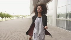 Full-length side view of slim african american business lady in short dress and - stock footage
