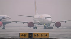 Generic Boeing 737-500 Commercial Passenger Airliner being Towed / Pulled on an Stock Footage