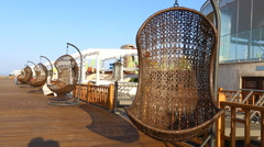 Empty hanging wicker chair aqua park in Baku, Azerbaijan - stock footage
