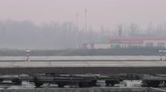 Moscow 2015-05-01 A320 moving on a taxiway in the airport in a rainy day. Some Stock Footage