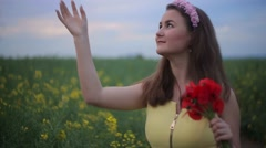 a garl on the grass, field with a telephone.mp4 - stock footage