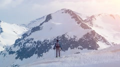 Successful Trekker Standing Snow Covered Mountain Celebrating Majestic Hiking Stock Footage