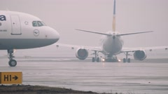 Moscow 2015-05-01 A320-200 lufthansa moving on a taxiway in the airport in a - stock footage
