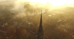 Static of a church covered in fog on an early morning with godrays Stock Footage
