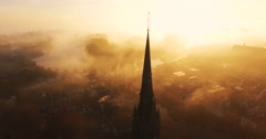 Camera tilts down showing a cross on top of a Christian church covered in fog Stock Footage