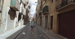 Young tourist woman walk alone at the gothic streets Stock Footage