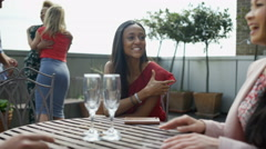 4K Happy group of friends chatting & socializing at outdoor bar or cafe table Stock Footage