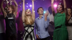 Friends of different nationalities dancing and throwing glitter confetti Stock Footage
