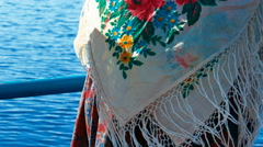 Woman Wearing Russian Traditional Shawl on a Boat Board - stock footage