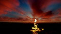 Beautiful timelapse sunrise over ocean, godrays, tilt Stock Footage